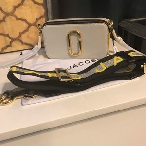 Marc Jacobs snapshot bags.
